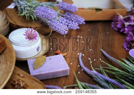 Natural organic artisan bath cosmetics, spa concept, wooden copy space for text