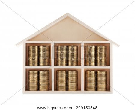 Wooden house with coins isolated on white