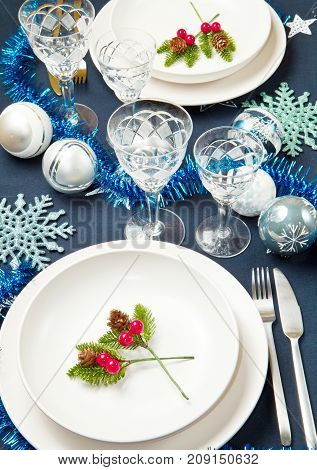 a decorated christmas table with cristal glass