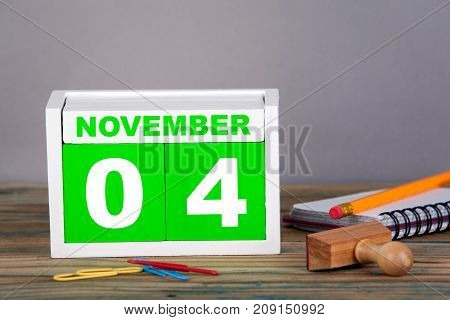 November 4. close-up wooden calendar. Time planning and business background.