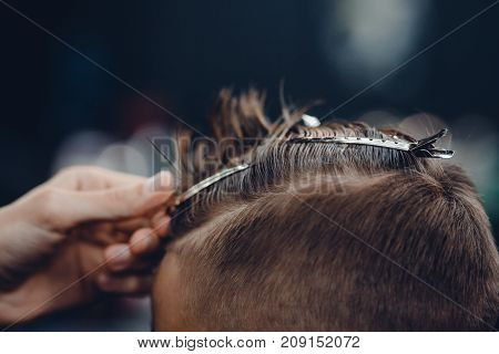 Barbershop. Close-up of a man's haircut, hair clips