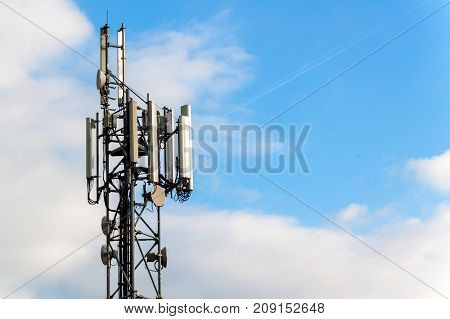 gsm column on a blue sky background. Mediation of the telephone signal. Modern technology