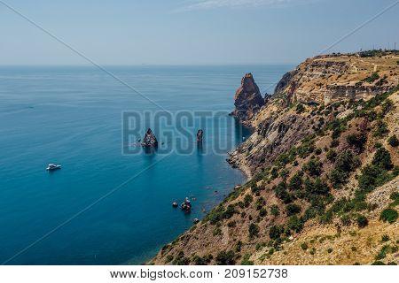 Beautiful view of the mountains and rocky coast of the azure Black sea, Cape Fiolent, Crimea