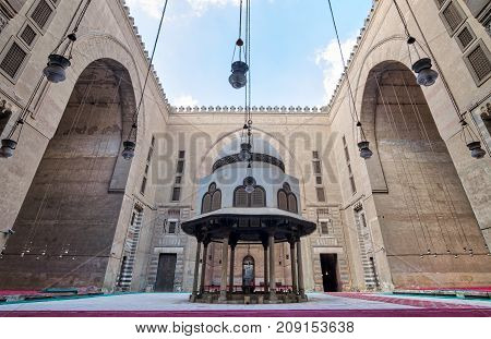 Courtyard of Sultan Hasan Mosque with ablution fountain and huge arches Old Cairo Egypt