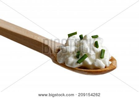 Chunky Cottage Cheese Garnished With Chives On Wooden Spoon Isolated On White.
