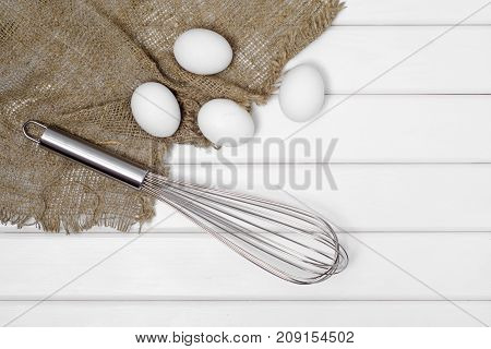 White eggs corolla on a white wooden background