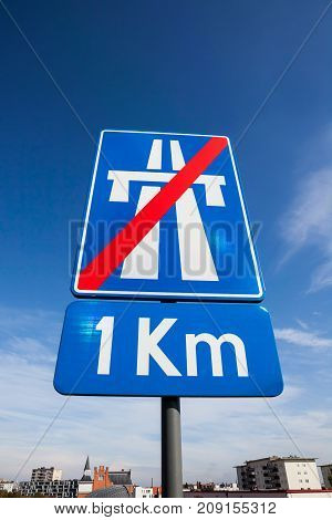 an traffic sign indicating the end of the highway