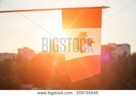 Flag Of Canada From Window Sunset Background
