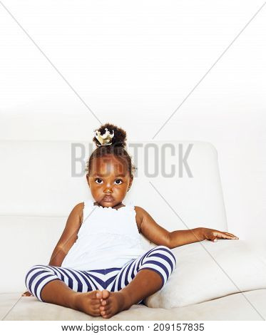 little cute african american girl playing with animal toys at home, pretty adorable princess in interior happy smiling, lifestyle real people concept closeup