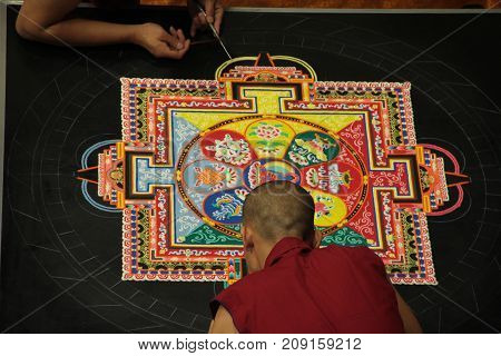 Tibetan monks sacred mandala creation August 2017 at the holocaust museum in Richmond Virginia.