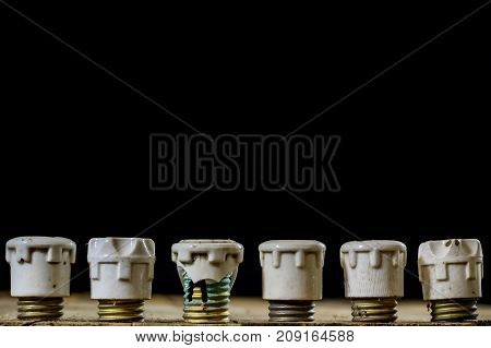 Old Ceramic Fuse Holders. Old Electrical Accessories. Wooden Table.