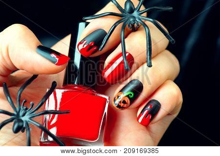 Halloween manicure design ideas. Halloween Nail art design. Nail Polish. Beauty hands. Trendy Stylish Colorful Nails and Nailpolish. Black matte nailpolish with blood drips and pumpkin