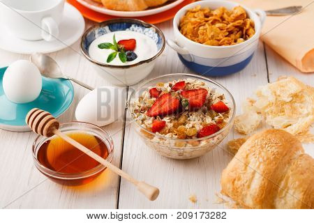 Rich continental breakfast menu. Delicious natural food for tasty morning meals on wooden table, traditional european buffet