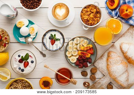 Rich continental breakfast menu background. Delicious natural food for tasty morning meals on wooden table, traditional european buffet