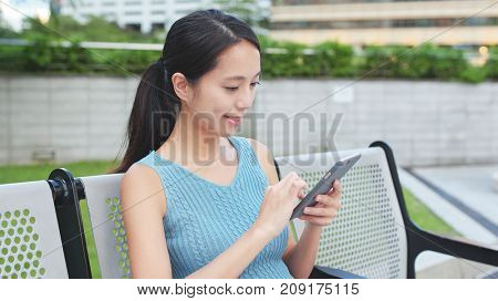 Woman use of mobile phone in the city