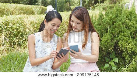 Women using mobile phone in the park