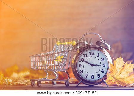 Vintage Alarm Clock And Maple Tree Leaves With Cart