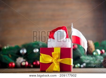 Gift Box With Poland Flag And Santa Claus Hat