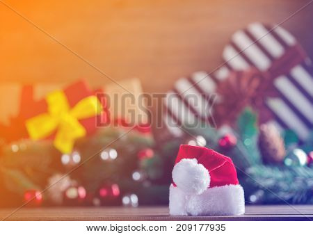 Santa Claus Hat With Pine Cones And Branches On Background