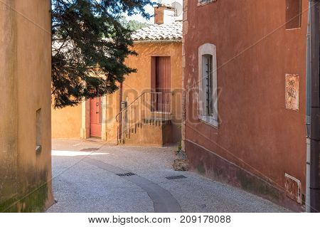 ROUSSILLON, FRANCE - APRIL 27, 2016: Street of medieval village of Roussillon. It ochre village is included in list of