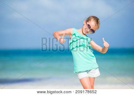 Silhouette of sporty little girl on white beach