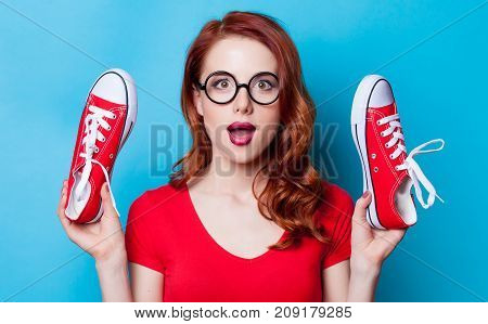Redhead Woman With Red Gumshoes