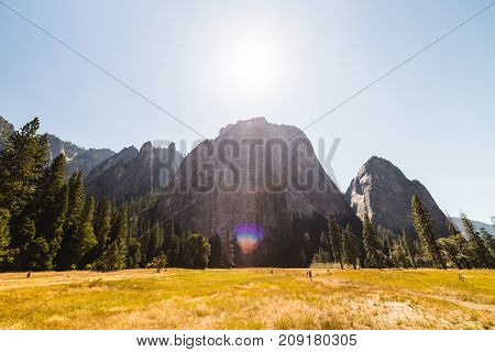 Sun Over Rock Formations In Yosemite
