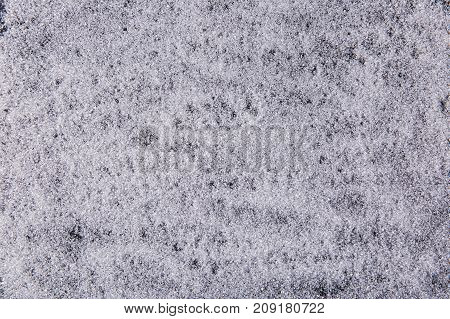Texture Of White Sugar Crystals On A Black Background