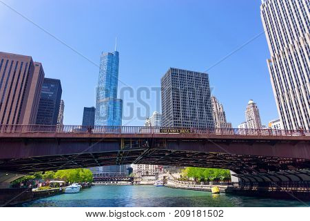 CHICAGO - MAY 12: Bridge and skyscrapers on the Chicago River in downtown Chicago on May 12 2017