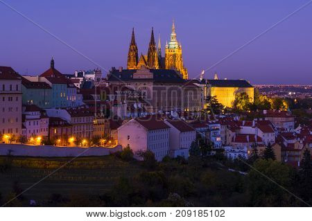 Prague castle complex with st Vitus cathedral at evening during dimming. Traditional view on the Prague castle illuminated by lights.Prague. Hradcany. Czech Republic