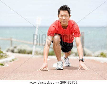 Young man getting ready for a run