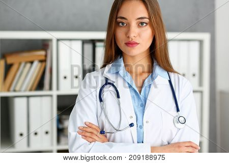 Beautiful smiling female doctor stand in office portrait. Physical and patient disease prevention ward round exam in 911 er prescribe remedy for healthy lifestyle nurse consultant profession concept