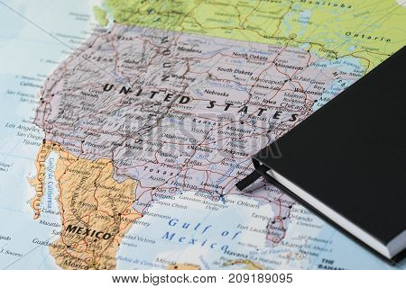 personal planner notes of a traveller planning a trip to United States of America over a closeup map of USA