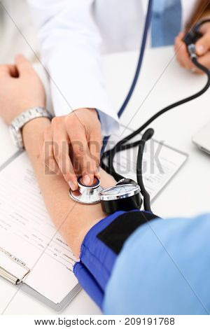 Female doctor arms make medic procedure closeup. Physical cure arterial beat exam tool nurse control and consult healthy lifestyle diagnosis therapeutist practice heal problem reception concept