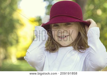 Portrait Of A Beautiful Little Girl With A Hat