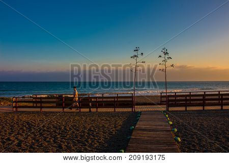 Beach. Summer sunset beach. Costa del Sol, Andalusia, Spain. Picture taken - 15 october 2017.