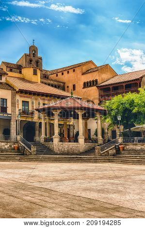 Plaza Mayor main square in Poble Espanyol an open air architectural museum on the Montjuic hill in Barcelona Catalonia Spain poster