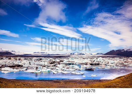 Sunrise in the Ice Lagoon. Drift ice Ice Lagoon - Jokulsarlon. Ice floes are reflected in the smooth water surface. The concept of extreme northern tourism