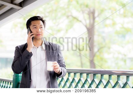 Portrait Of A Confident Business Man Talking Cell Phone Call Outdoor.