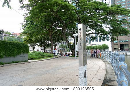 SINGAPORE - OCTOBER 13 2017: Jubilee Walk is a trail that connects the past, present and future elements of ... Empress Place along the Singapore River