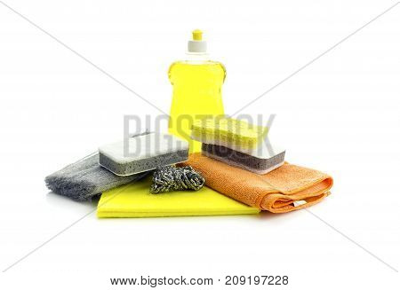 Bright, different kitchen washcloths and detergent on white background closeup