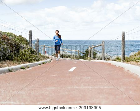 Young Woman Jogging at the seaside