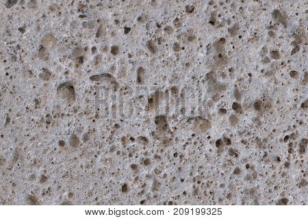 Texture of the stone surface. Gray textured wall.