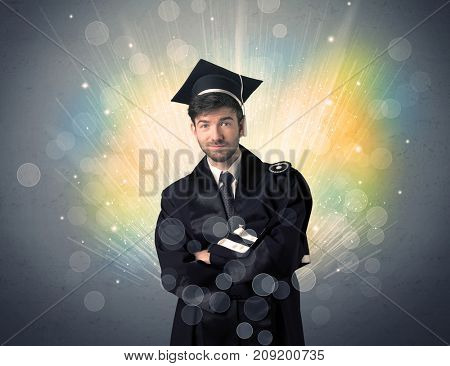 Happy graduate with colorful bokeg lights in the background grunge wall
