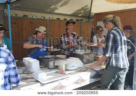 Cooking And Serving Food At Local Festival