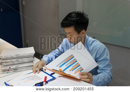 Businessman reading document report in the meeting room