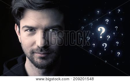 businessman with many question mark near him
