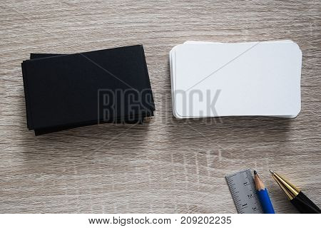 Blank black business card mock up on office desk use us for mock up contact id information design template , clipping path on card.