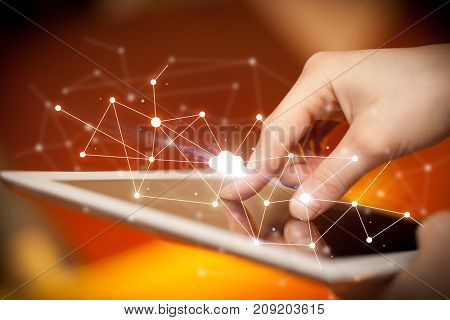 Female hands touching tablet with white cloud concept