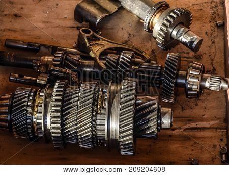 Dismantled Box Car Transmissions. The Gears On The Shaft Of A Me